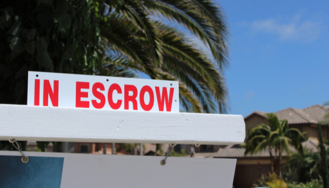 An escrow sign outside a home representing the escrow closing documents
