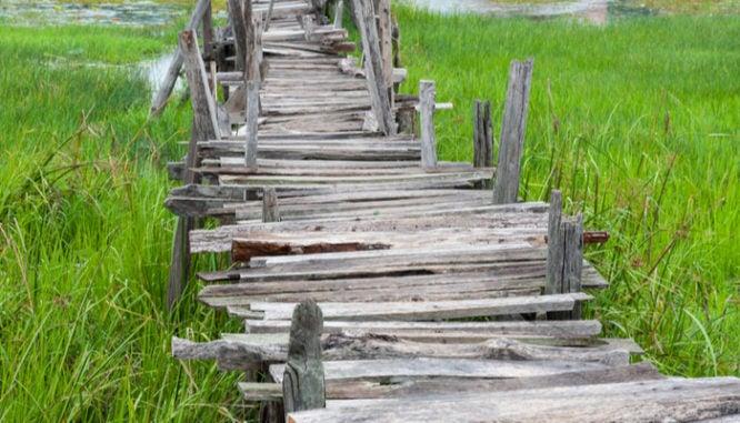 A rickety bridge symbolizes closing document pitfalls