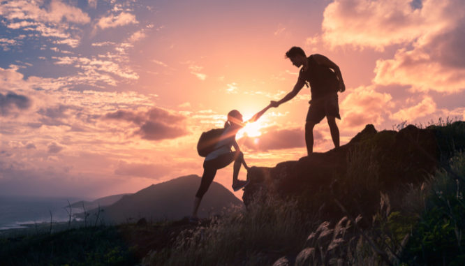 people helping each other hike up a mountain symbolizes a helping hand for buyers to get rid of pmi
