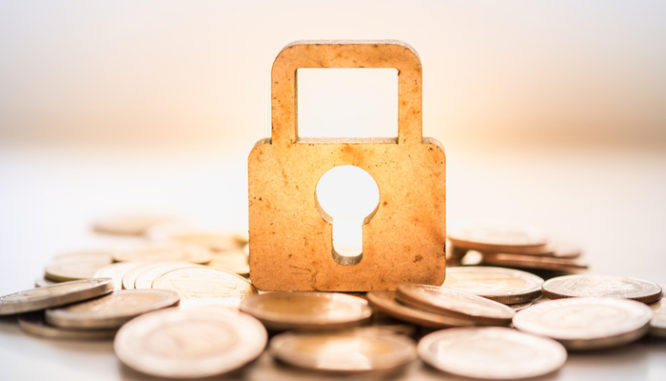 A wooden master key lock icon to symbolize what a mortgage broker does not do: lend money