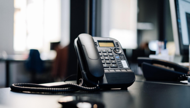A photo of a phone represents the need to work with an agent when buying a bank owned property.