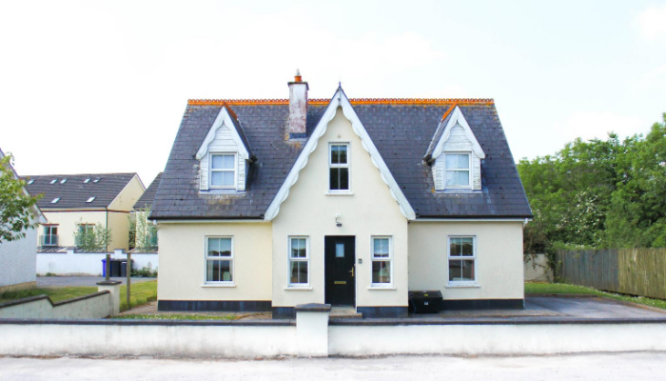 A photo of a house represents the topic of buying a bank owned home.