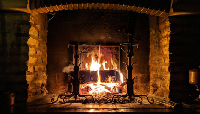 A photo of a fireplace illustrates the topic of common repairs needed after a home inspection.