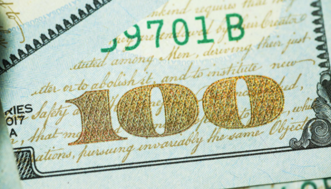 A photo of cash illustrates the importance of income level in first time buyer programs.