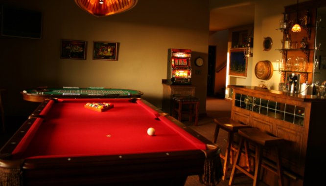 A pool table in a home with a low appraisal.