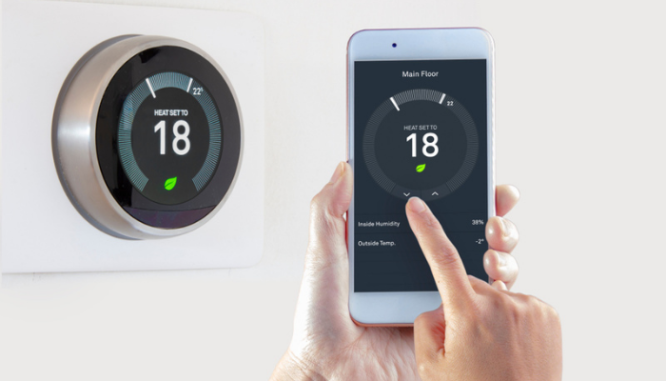 A smart thermostat in a home that saves energy.