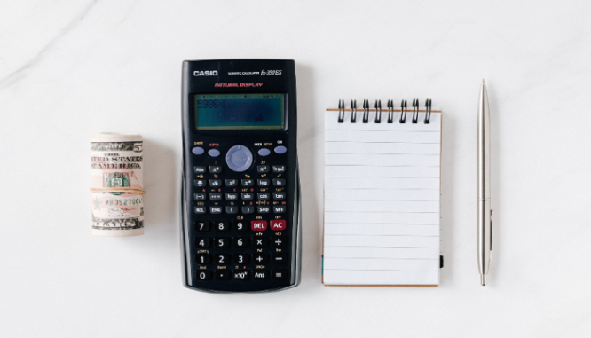A calculator and notebook used to make an offer on a short sale.